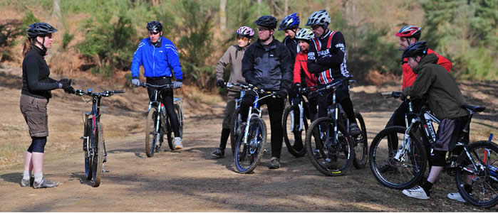 Coach Jessica Weston explains off-road technique to a group of eager students