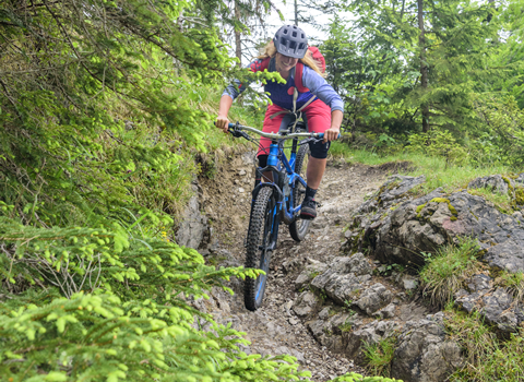 A rider tackling a rocky drop-off